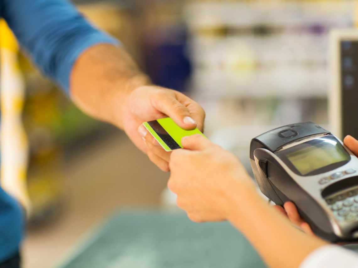 mobile payments made by a man at a local store