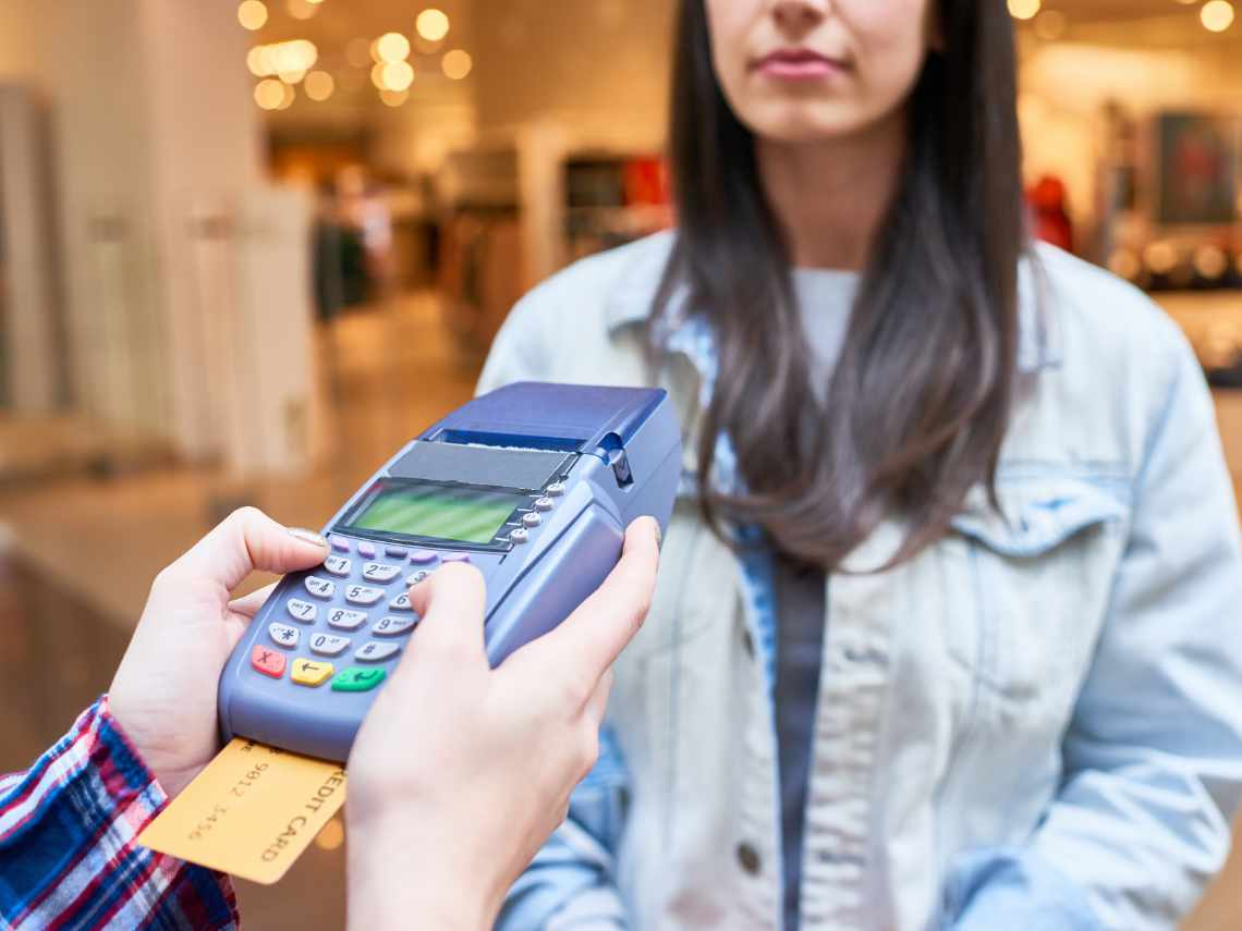 credit card software allowing a woman to make a payment with her credit card