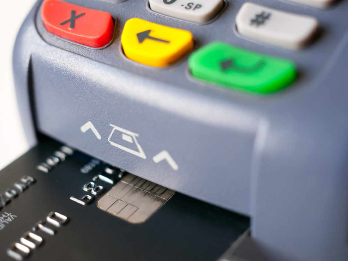 chip card being inserted into a credit card processing machine