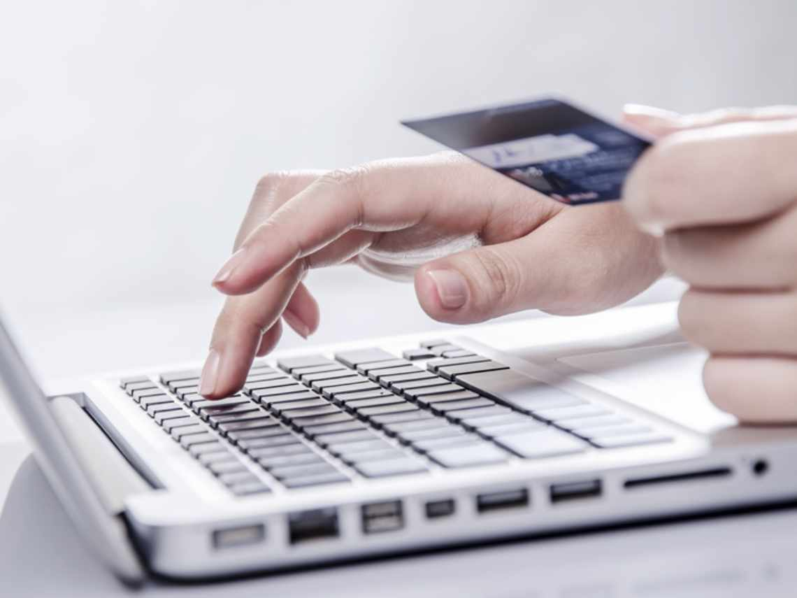 online credit card payment being processed on a white laptop